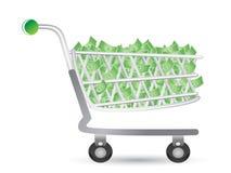 Carro de compras llenado del dinero Fotos de archivo libres de regalías
