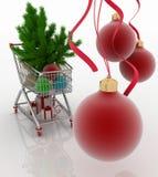 Carro de compras por completo con las bolas de la Navidad cajas del abeto y de regalo Imagen de archivo