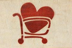 Carro de compras rojo del corazón Imágenes de archivo libres de regalías