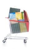 Carro de compras rojo grande por completo de los bolsos de compras Imagen de archivo libre de regalías