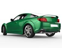 - Carro de corridas moderno verde no fundo branco - vista lateral traseira escura Imagem de Stock Royalty Free