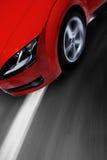 Carro de esportes rápido que move-se com borrão Fotos de Stock Royalty Free
