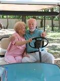 Carro de golfe - condução do banco traseiro Fotografia de Stock