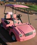 Carro de golfe das senhoras cor-de-rosa Fotografia de Stock