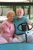 Carro de golfe - romance Fotografia de Stock Royalty Free