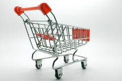 Carro de la compra, carretilla en el fondo blanco Imagen de archivo