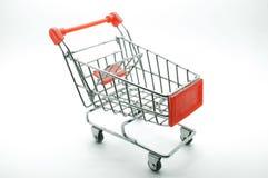 Carro de la compra, carretilla en el fondo blanco Imagenes de archivo
