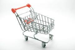 Carro de la compra, carretilla en el fondo blanco Imágenes de archivo libres de regalías