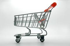 Carro de la compra, carretilla en el fondo blanco Fotos de archivo libres de regalías