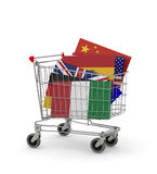 Carro de la compra con muchas banderas dentro Imagenes de archivo