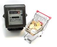 Carro de la compra del dinero europeo para pagar las cuentas de la electricidad Foto de archivo libre de regalías