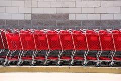 Carro de la compra en fila Fotos de archivo