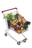 Carro de la compra llenado de los productos alimenticios aislado en el fondo blanco, no imagenes de archivo