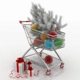 Carro de la compra por completo con las bolas de la Navidad con las cajas del abeto y de regalo Imágenes de archivo libres de regalías