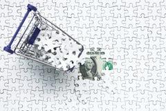 Carro de la compra por completo del rompecabezas en fondo del dólar del dinero, fotos de archivo