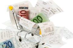 Carro de la compra, recibos y dinero Foto de archivo