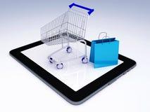 Carro de la compra sobre Tablet PC Concepto del comercio electrónico libre illustration