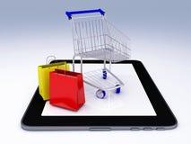 Carro de la compra sobre Tablet PC Concepto del comercio electrónico Fotografía de archivo