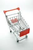 Carro de la compra vacío, carretilla en el fondo blanco Foto de archivo libre de regalías