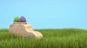 Carro de madeira de easter com os dois ovos no telhado em um gra verde suculento Fotos de Stock