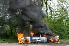 Carro de polícia ardente Fotos de Stock Royalty Free
