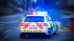 Carro de polícia com luzes de emergência sobre Fotos de Stock