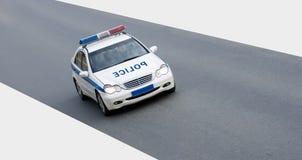 Carro de polícia isolado na estrada imagem de stock royalty free