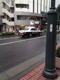 Carro de polícia no Tóquio fotografia de stock royalty free