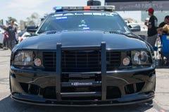 Carro de polícia de ajustamento Fotografia de Stock Royalty Free