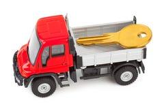 Carro del coche del juguete con clave Fotos de archivo