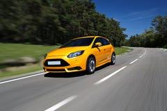 Carro desportivo global que conduz a parte dianteira fotografia de stock royalty free