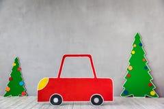 Carro do cartão e árvore de Natal Foto de Stock Royalty Free