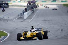 Carro do GP do A. 1 de Malaysia da equipe. no início Imagem de Stock Royalty Free