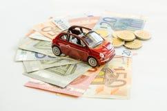 Carro e dinheiro vermelhos Imagens de Stock