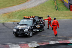 Carro e equipe do salvamento Fotografia de Stock