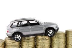 Carro em moedas Foto de Stock