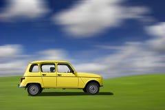 Carro engraçado amarelo Foto de Stock Royalty Free