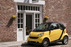 Carro esperto amarelo fotografia de stock royalty free