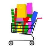 Carro lleno de la carretilla de las compras con los panieres y las cajas de regalo Foto de archivo