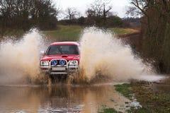Carro nas inundações Fotos de Stock Royalty Free