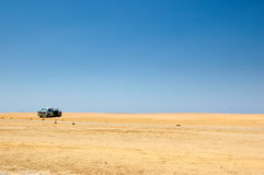 Carro no deserto Foto de Stock Royalty Free
