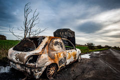 Carro para fora queimado Fotos de Stock Royalty Free