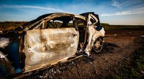 Carro para fora queimado Imagem de Stock