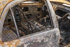 Carro para fora queimado interior Fotografia de Stock Royalty Free