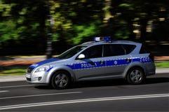 Carro policial polonês no movimento Foto de Stock Royalty Free