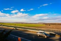 Carro que viaja na estrada no sunse Fotos de Stock Royalty Free