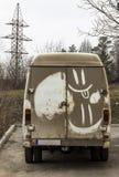 Carro sujo com sorriso Imagens de Stock