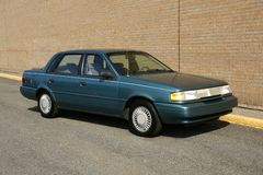 Carro usado do Topaz do Mercury fotografia de stock