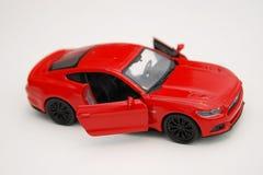 Carro vermelho diminuto do brinquedo Fotografia de Stock Royalty Free