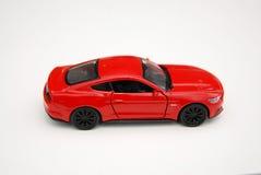Carro vermelho diminuto do brinquedo Fotos de Stock Royalty Free